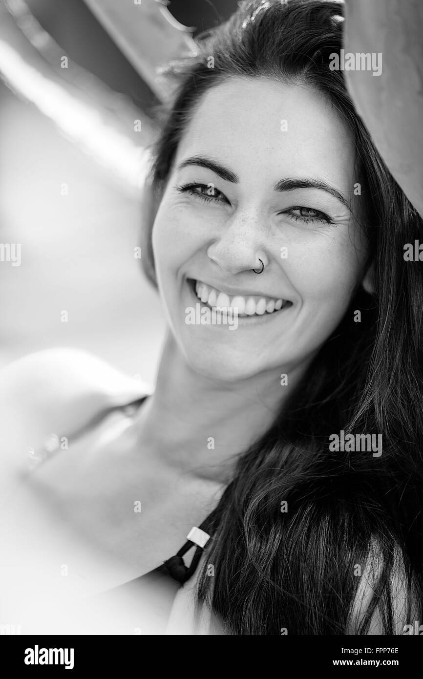Woman smiling at camera, portrait, b/w, - Stock Image