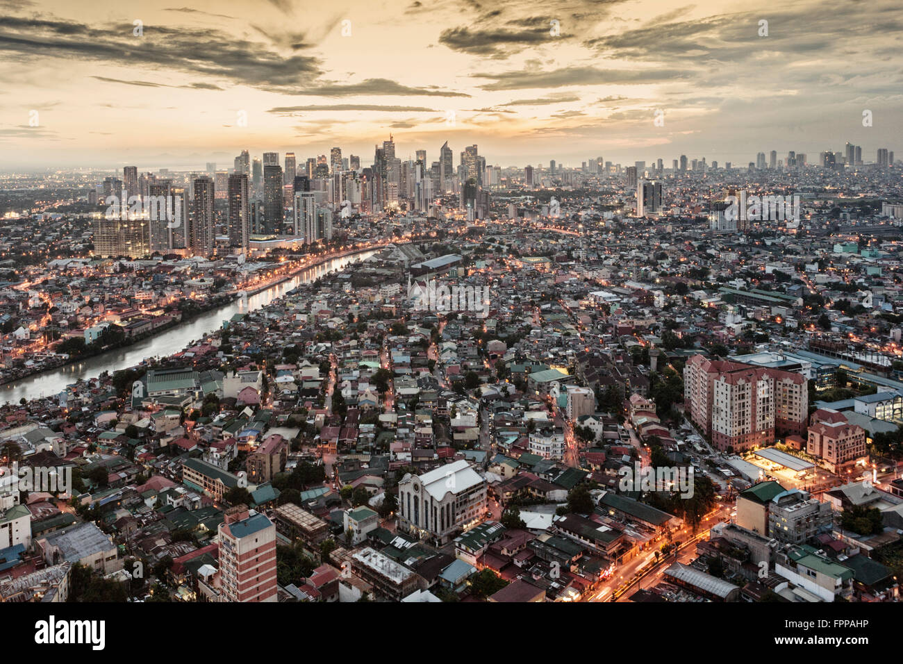 Asia, East Asia, Philippines, Manila, Makati and Pasig river, business district, skyscrapers, city skyline, sunset - Stock Image