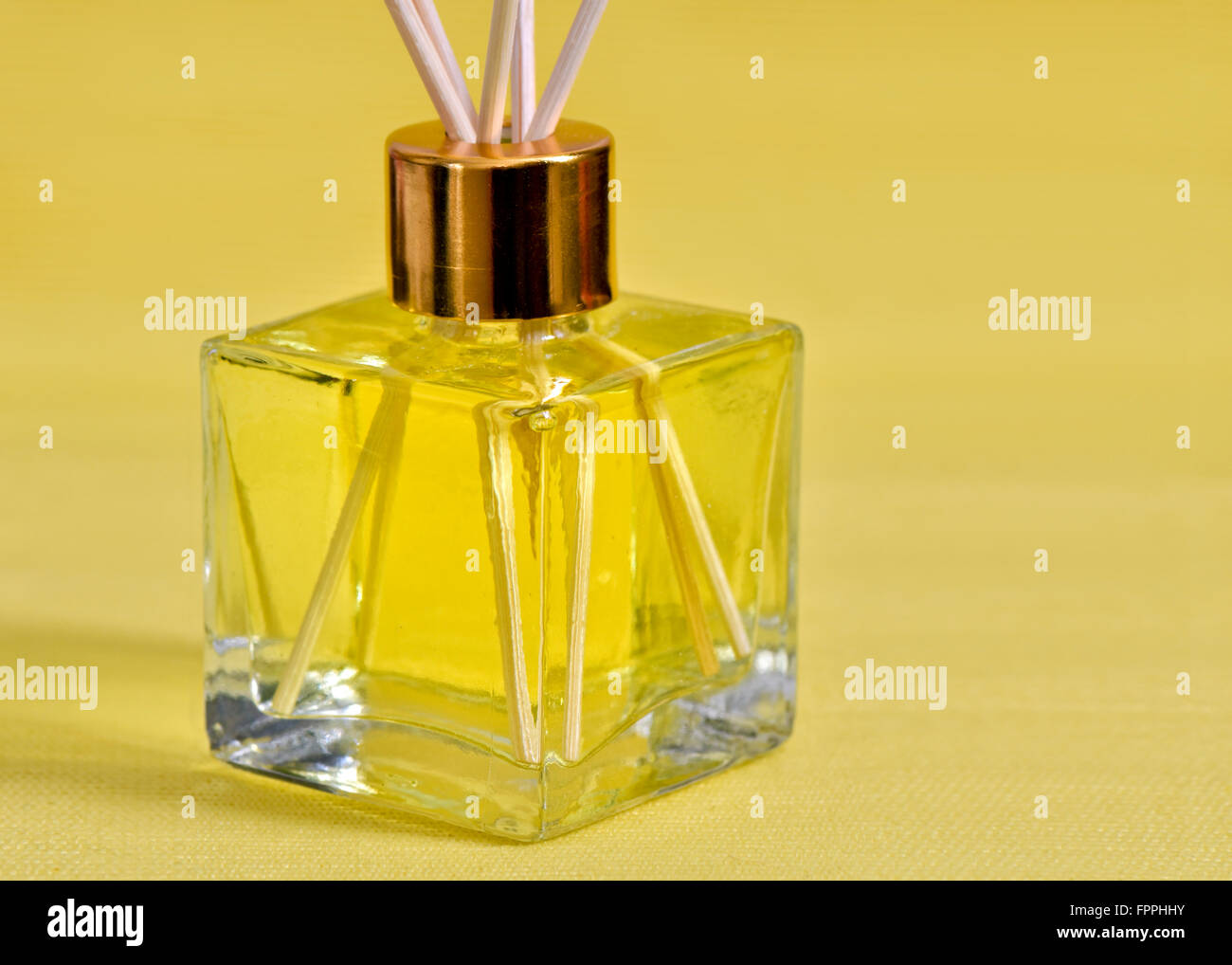 Reed diffuser room scenter on a yellow background - Stock Image