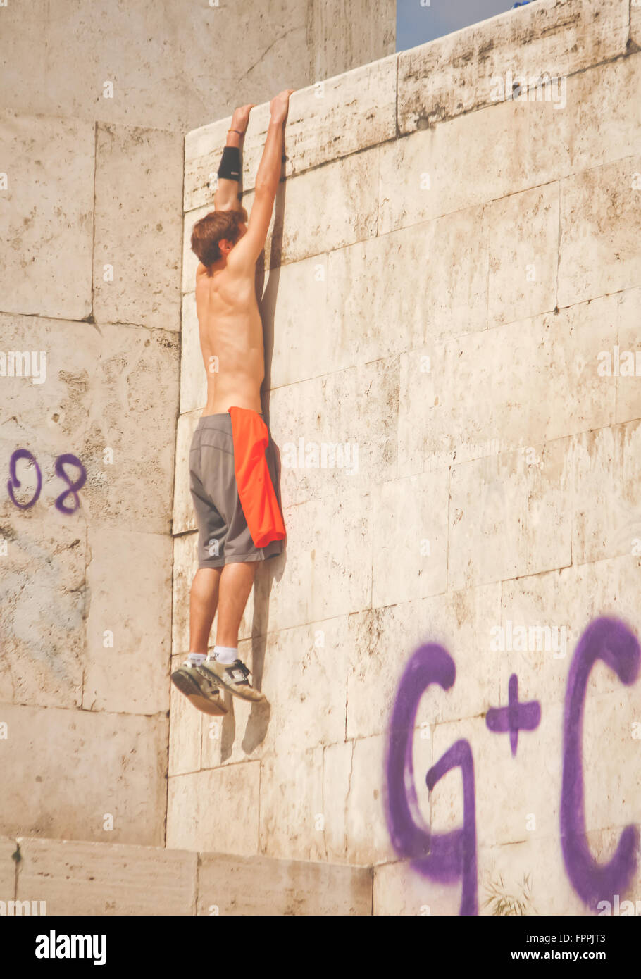Rome, Italy - March 14, 2010: unidentified young man training in parkour. - Stock Image
