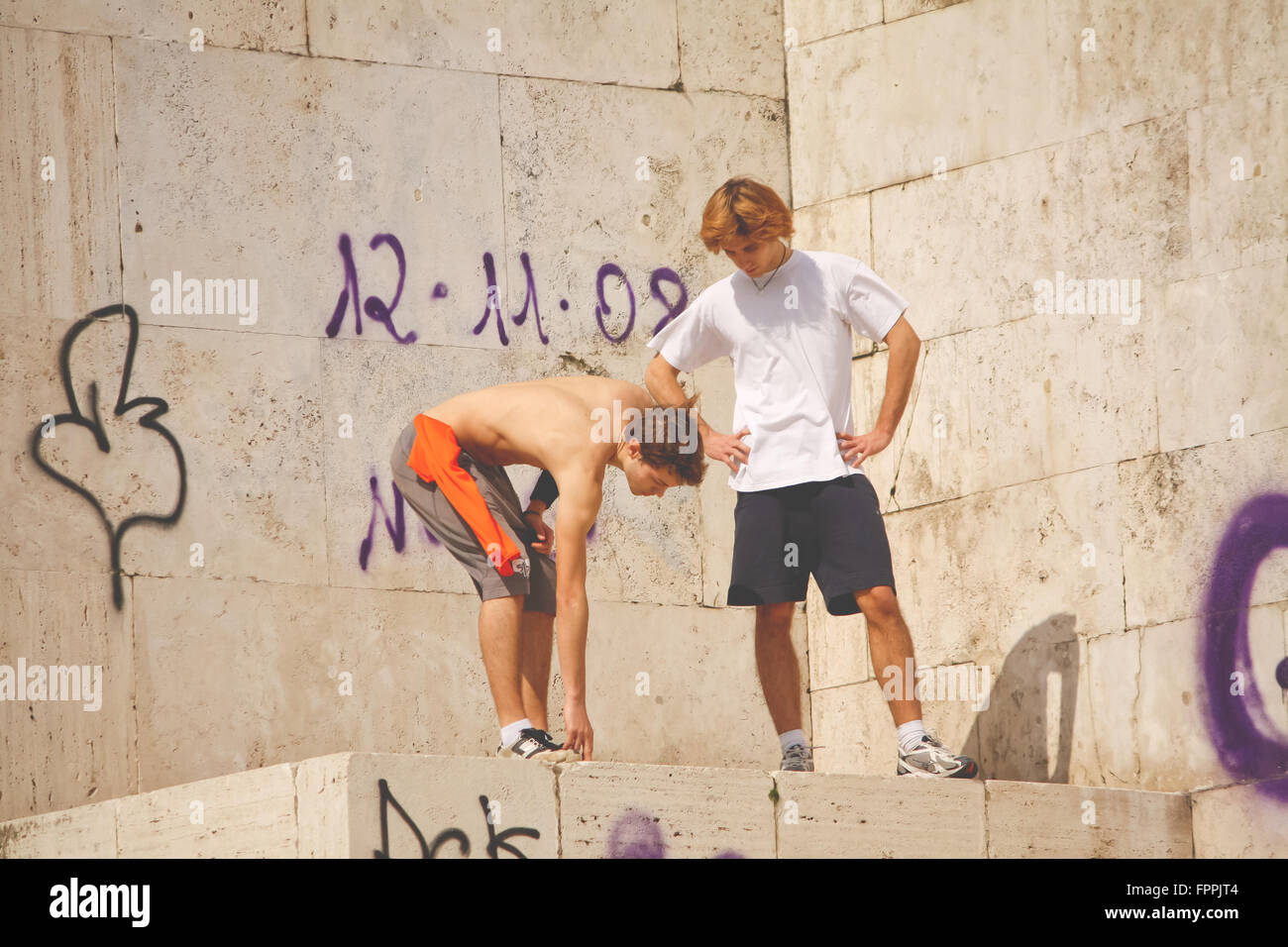 Rome, Italy - March 14, 2010: unidentified young men training in parkour.. - Stock Image