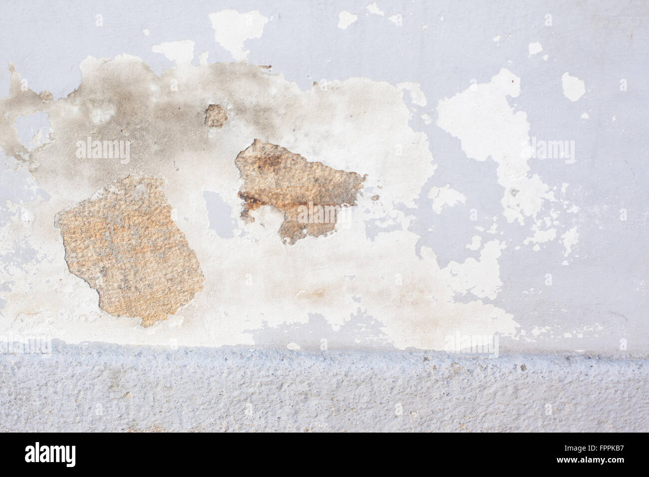 Worn stucco and paint wall - Stock Image