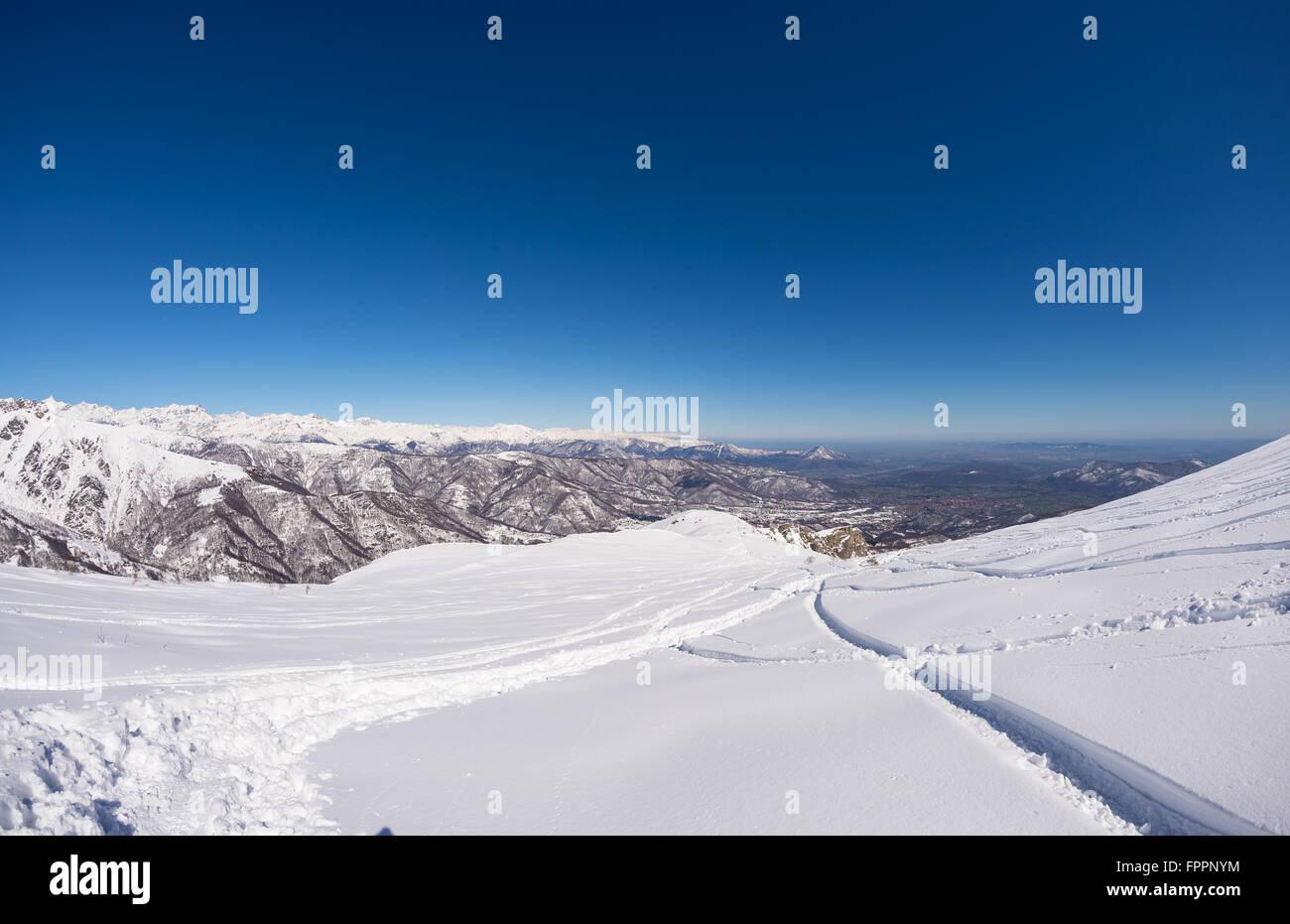 Free ride ski tracks on snowy slope  Fresh powder snow in a bright