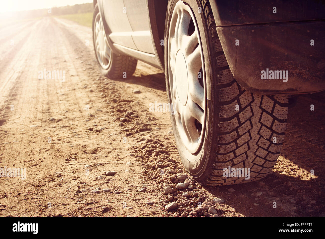car tire on dirt road Stock Photo