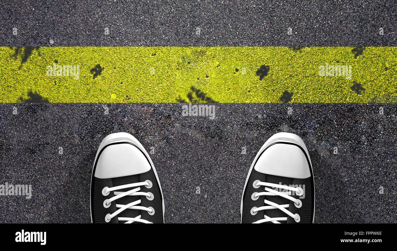 Cross the yellow line ? Concept illustration showing shoes in front of a yellow line. - Stock Image