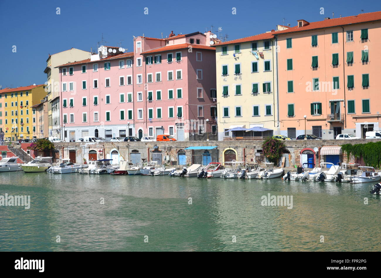 Picturesque view on boats in city channel in Livorno, Italy - Stock Image