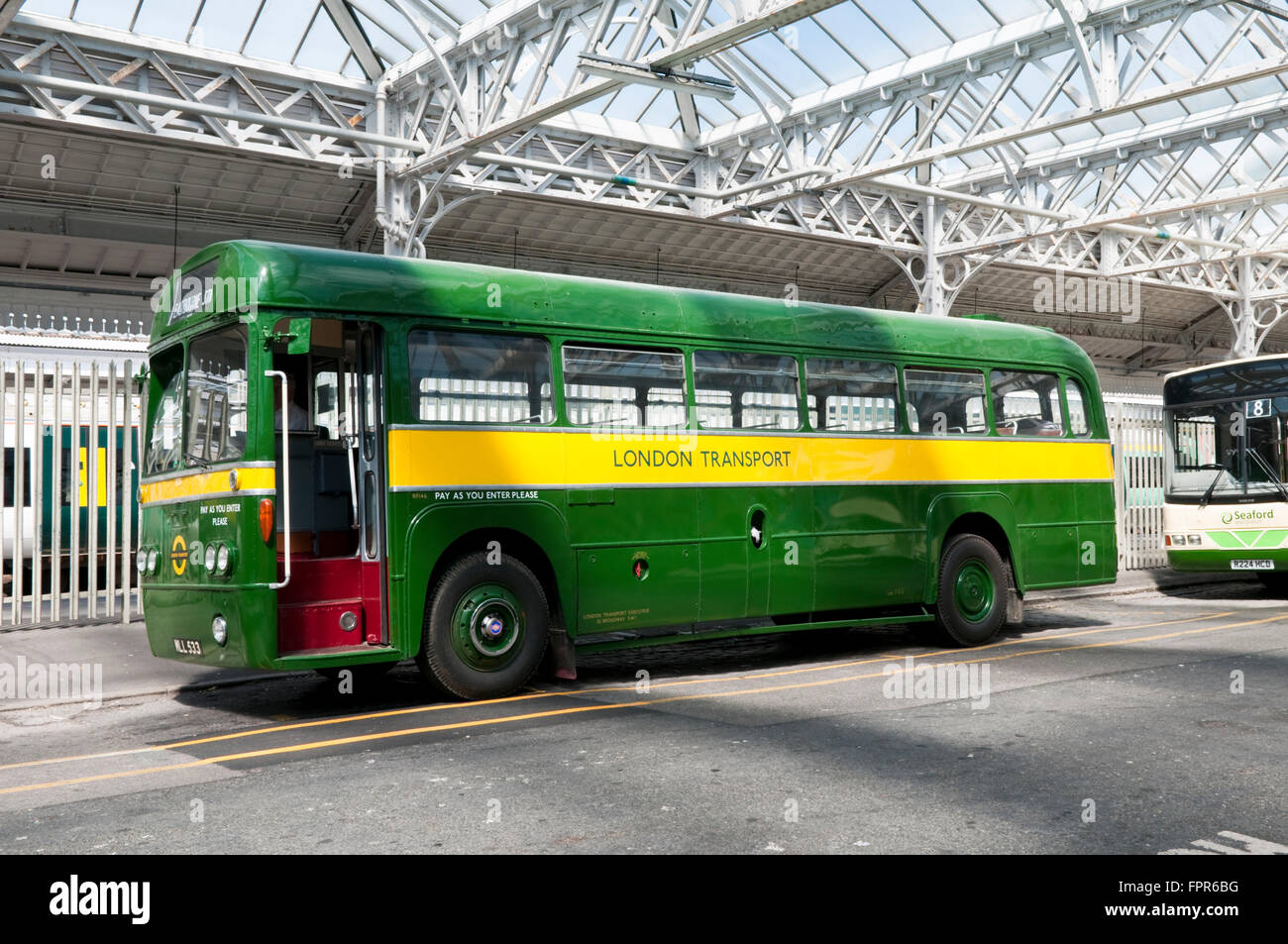 A vintage green and yellow AEC RF London Transport single decker bus at a rally in Eastbourne, East Sussex - Stock Image