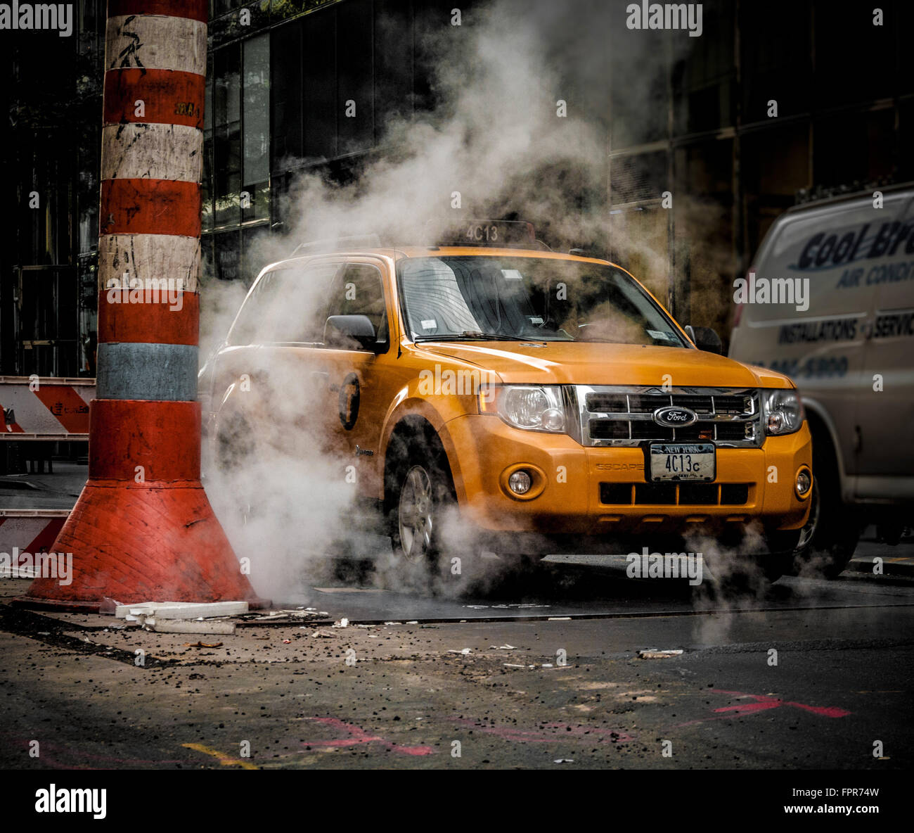 Taxi and steam vent, New York City, USA - Stock Image