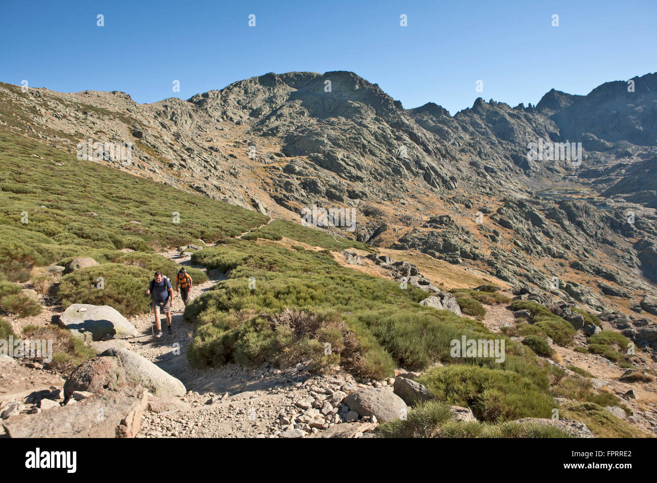 Europe, Spain, Castile-Leon, Sierra de Gredos, National park, hikers on a trail, rugged mountain view - Stock Image