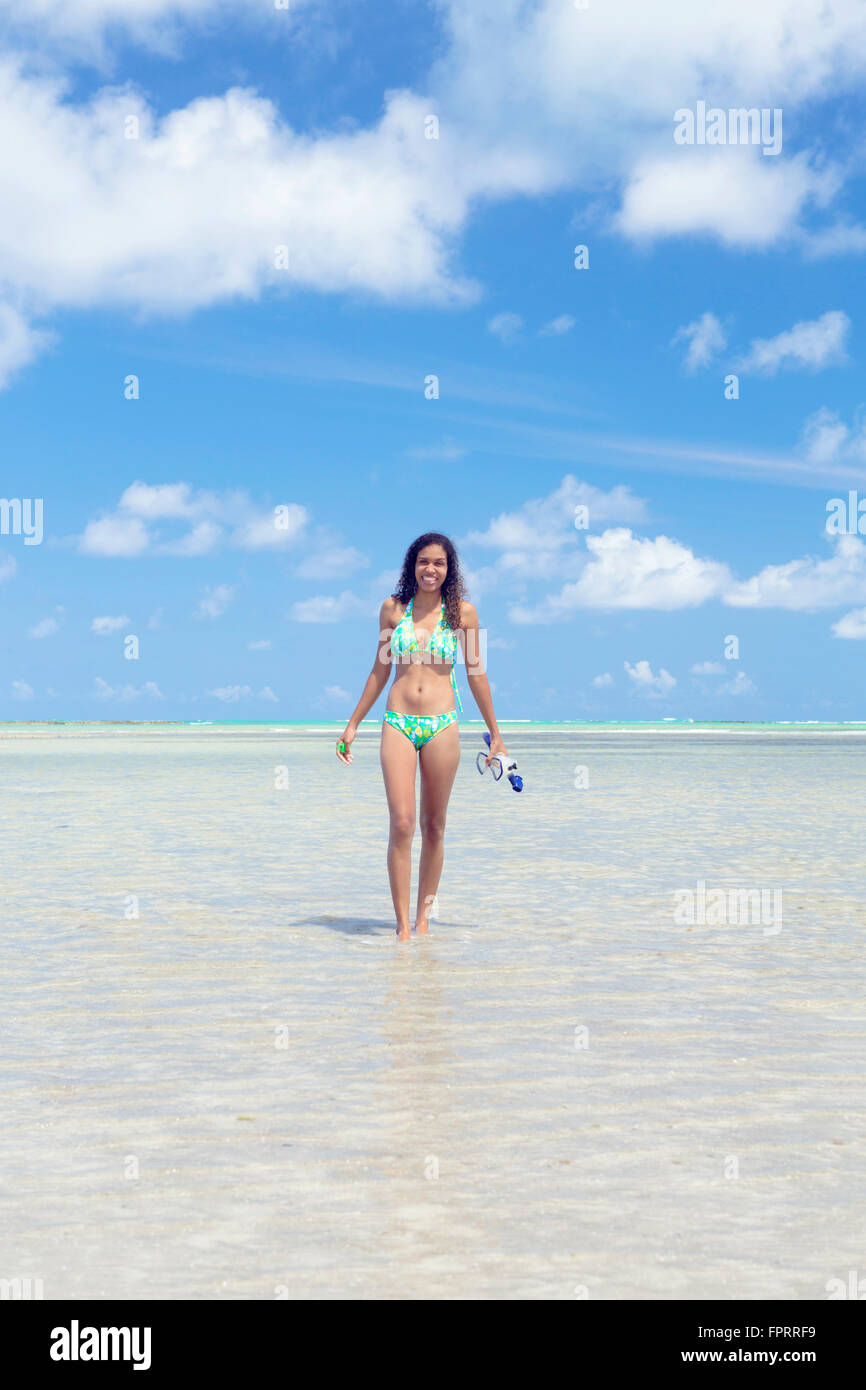 Solo mixed race traveler on a beautiful, empty tropical beach - Stock Image