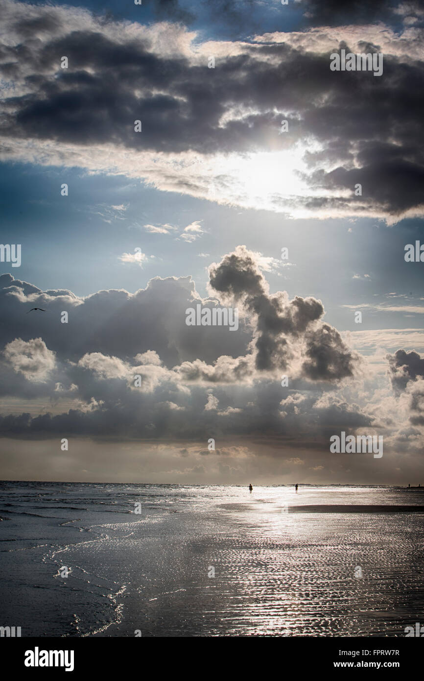 Flat beach with cloudy sky, Langeoog, Lower Saxony, Germany - Stock Image