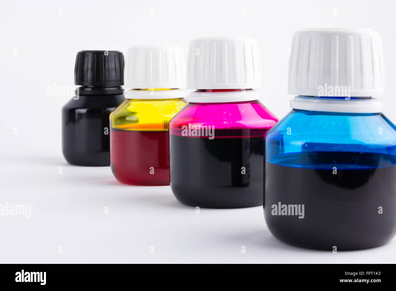cyan, magenta, yellow and black inkjet refill colors in bottles - Stock Image