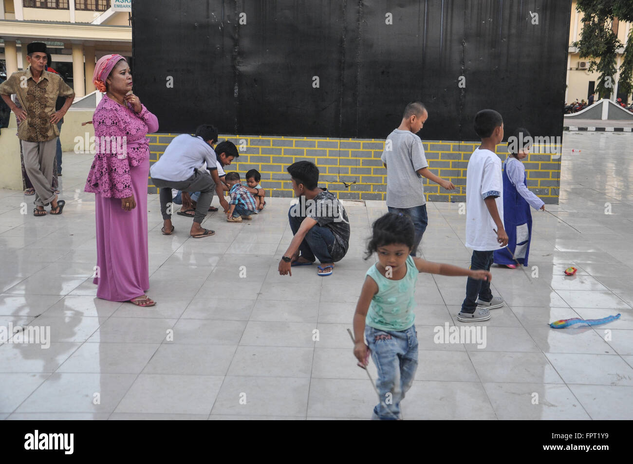 Makassar, Indonesa. Kids play at a public space. - Stock Image