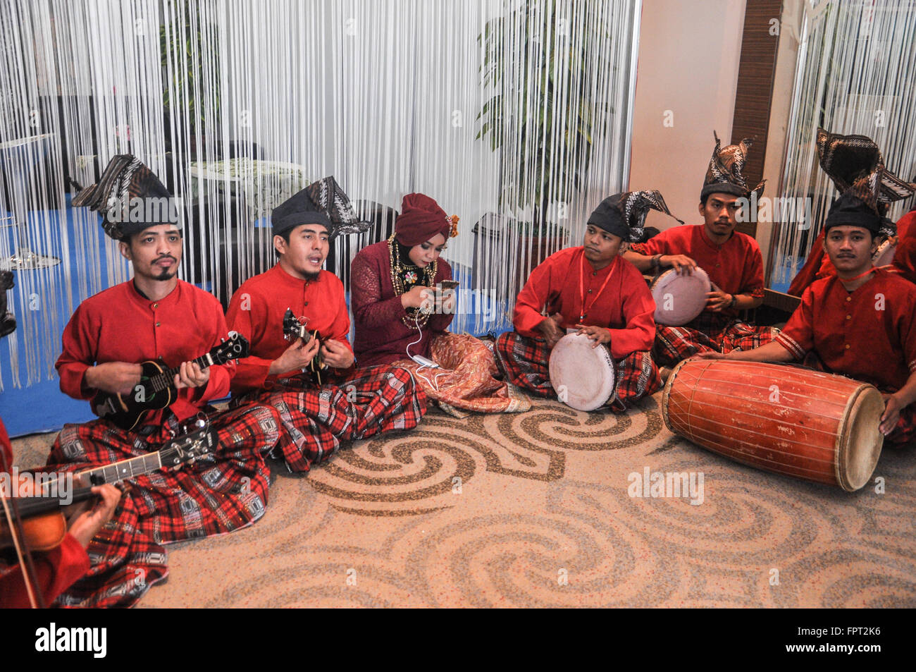 Makassar, Indonesia. People plays traditional music of South Sulawesi In Makassar, Indoensia - Stock Image