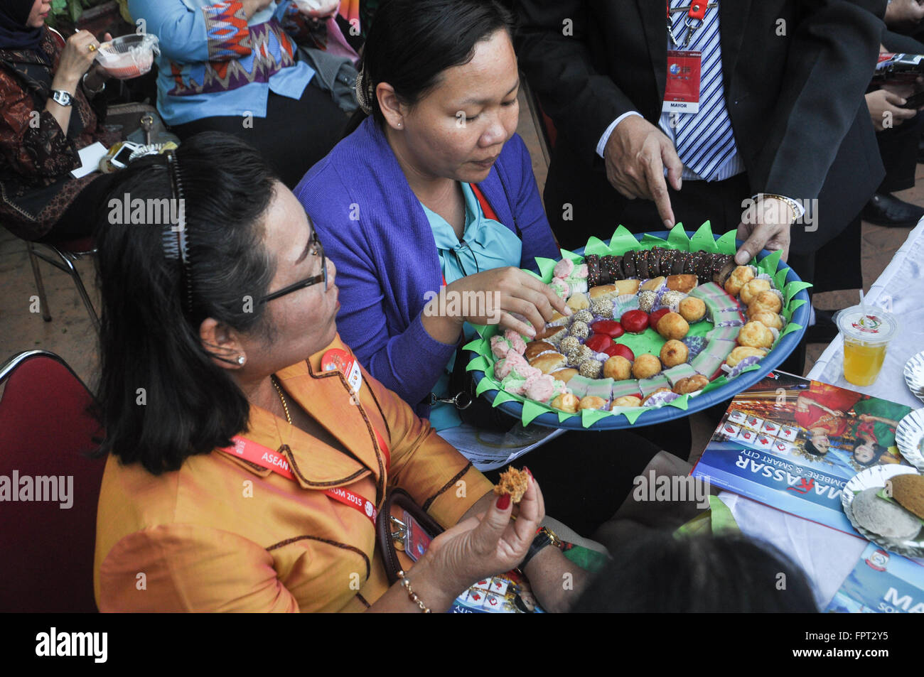 Delegations from many cities in South East Asia enjoyed local food made by Kassi-Kassi Village reidents during ASEAN - Stock Image