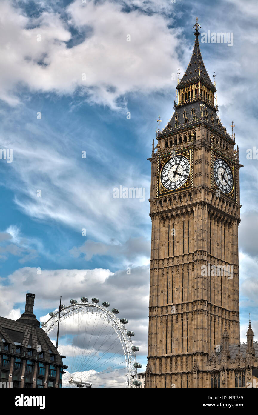 Big Ben with London Eye in the background, Houses of Parliament London - Stock Image