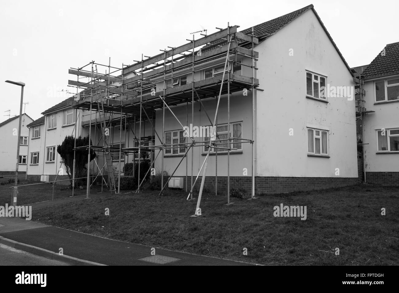Access scaffolding on a small British apartment block of flats. March 2016 - Stock Image