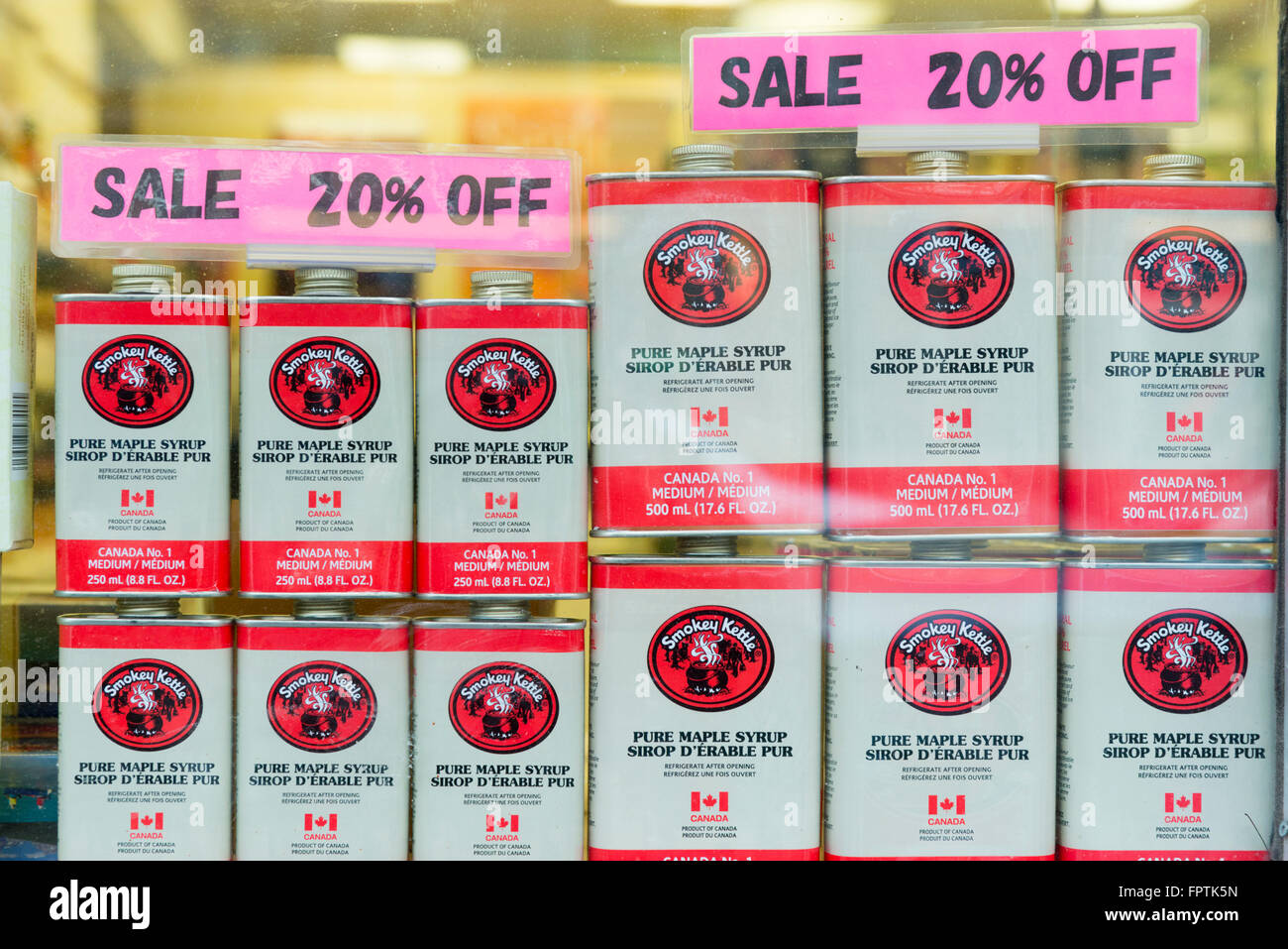 Tins of Maple syrup for sale in a shop window in Banff Canada - Stock Image