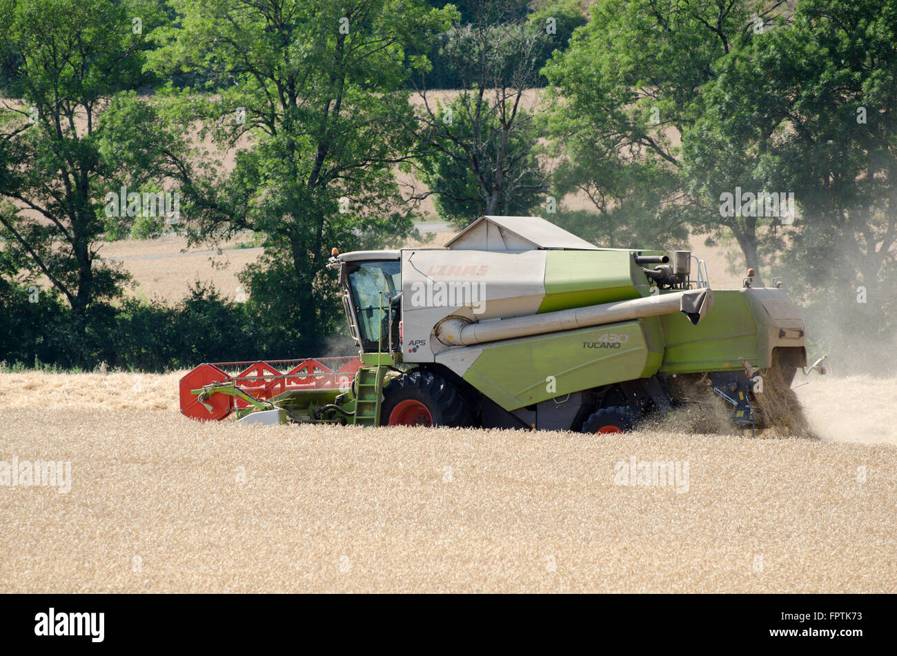 Combine harvester in a field in France - Stock Image