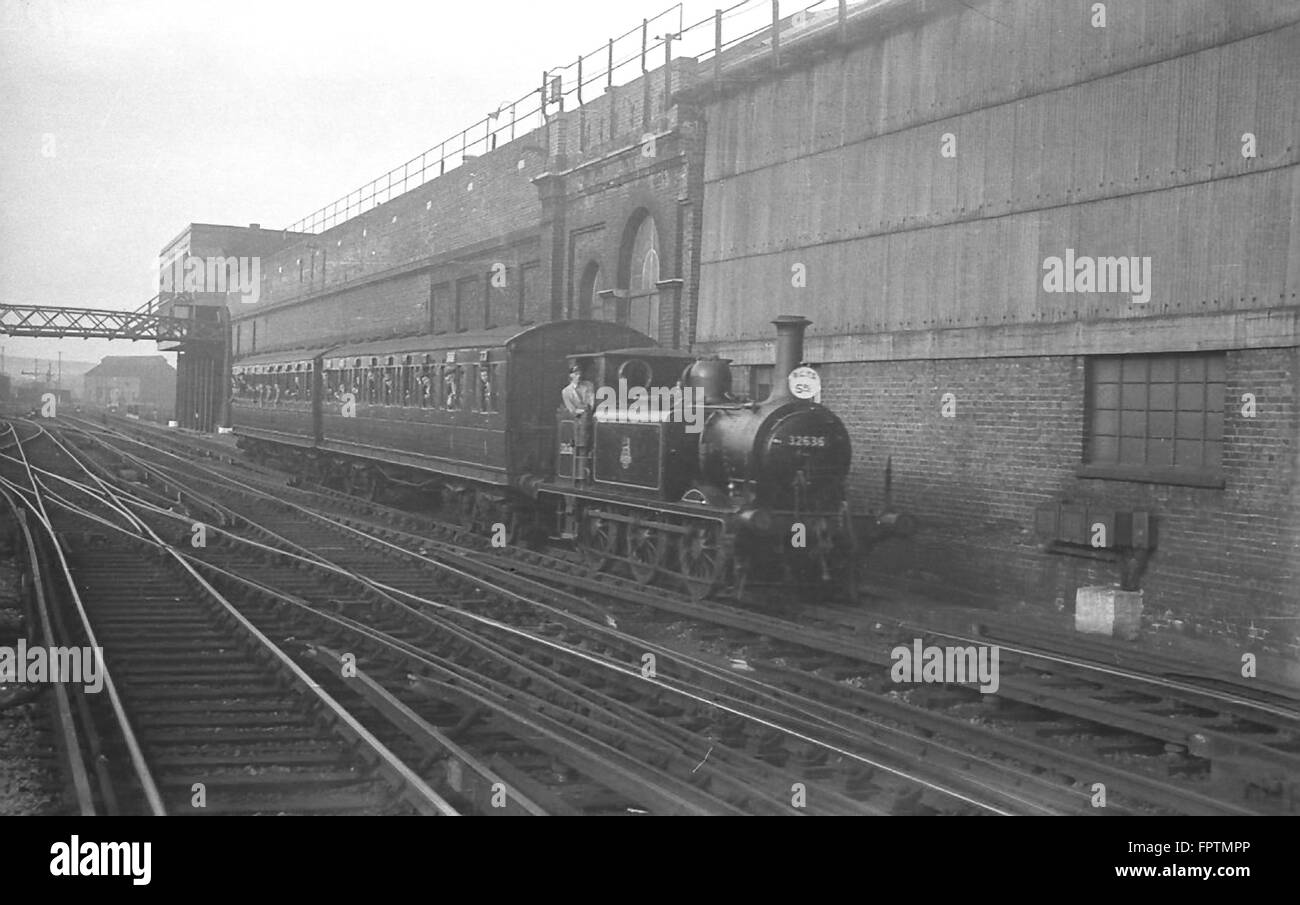 LBSCR A1X Terrier 0-6-0T hauls an RCTS Excursion past Brighton shed with an RCTS excursion to Brighton (Kemp Town) on 5th October 1952 Stock Photo