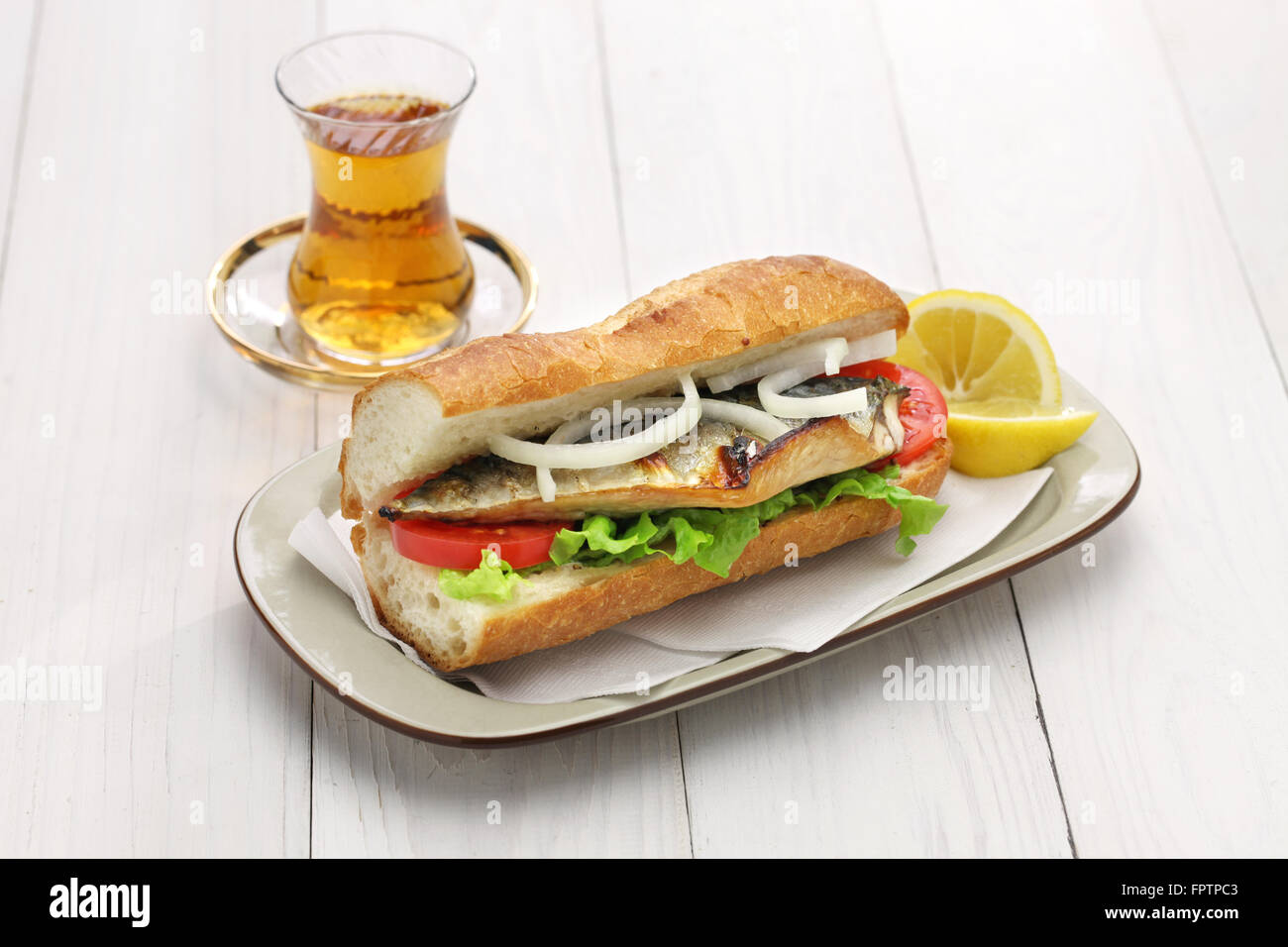 mackerel fish sandwich and a glass of tea,turkish food - Stock Image