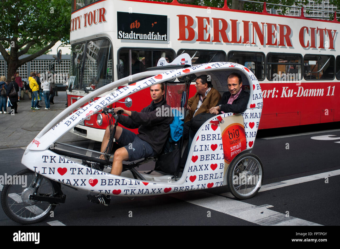 Turistic bus and Tourist Bicycle in Berlin, Germany. Berliner City Bus. If you decided to visit Berlin, a bike tour - Stock Image