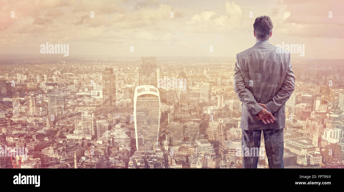 Businessman looking across the city of London financial district - Stock Image