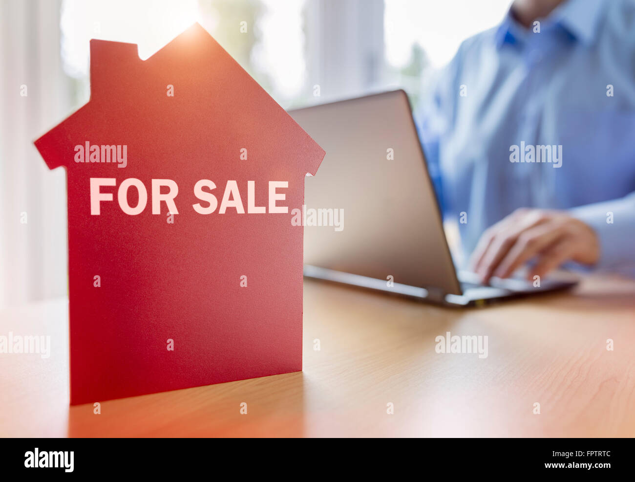 Searching the internet for real estate or new house - Stock Image