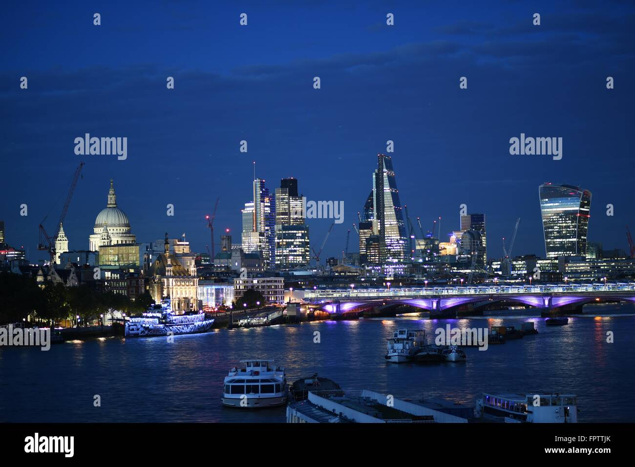 A Night Shot of beautifully lit London City overlooking The River Thames and famous landmarks - Stock Image