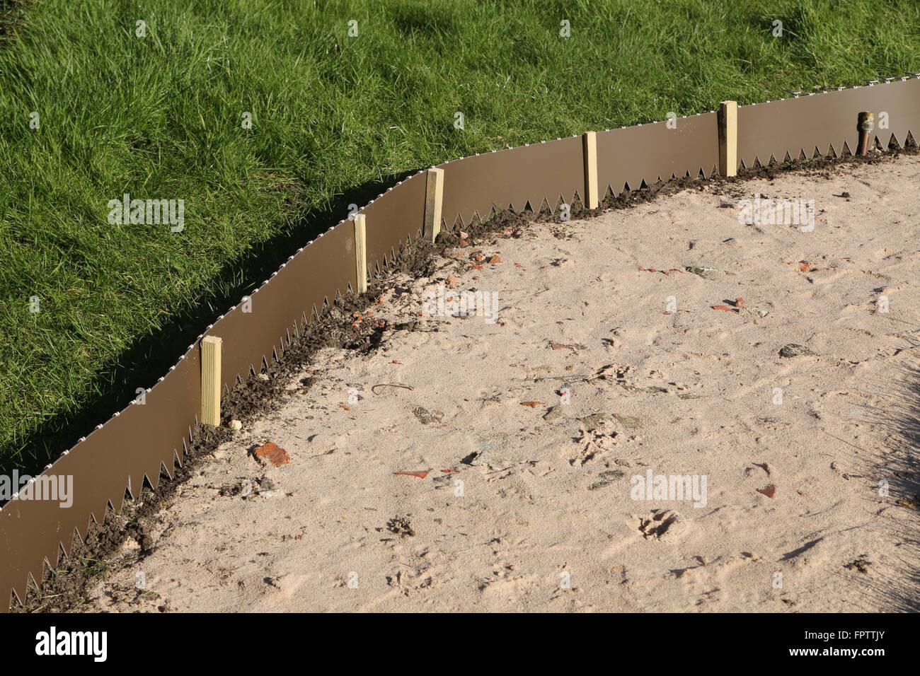 Laying New Garden Path - Lawn Edging Strip Surrey England - Stock Image