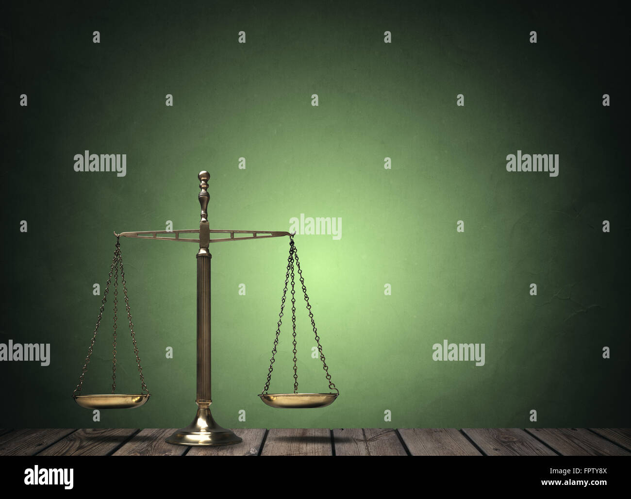 Law scales on wooden desk concept for justice and equality - Stock Image