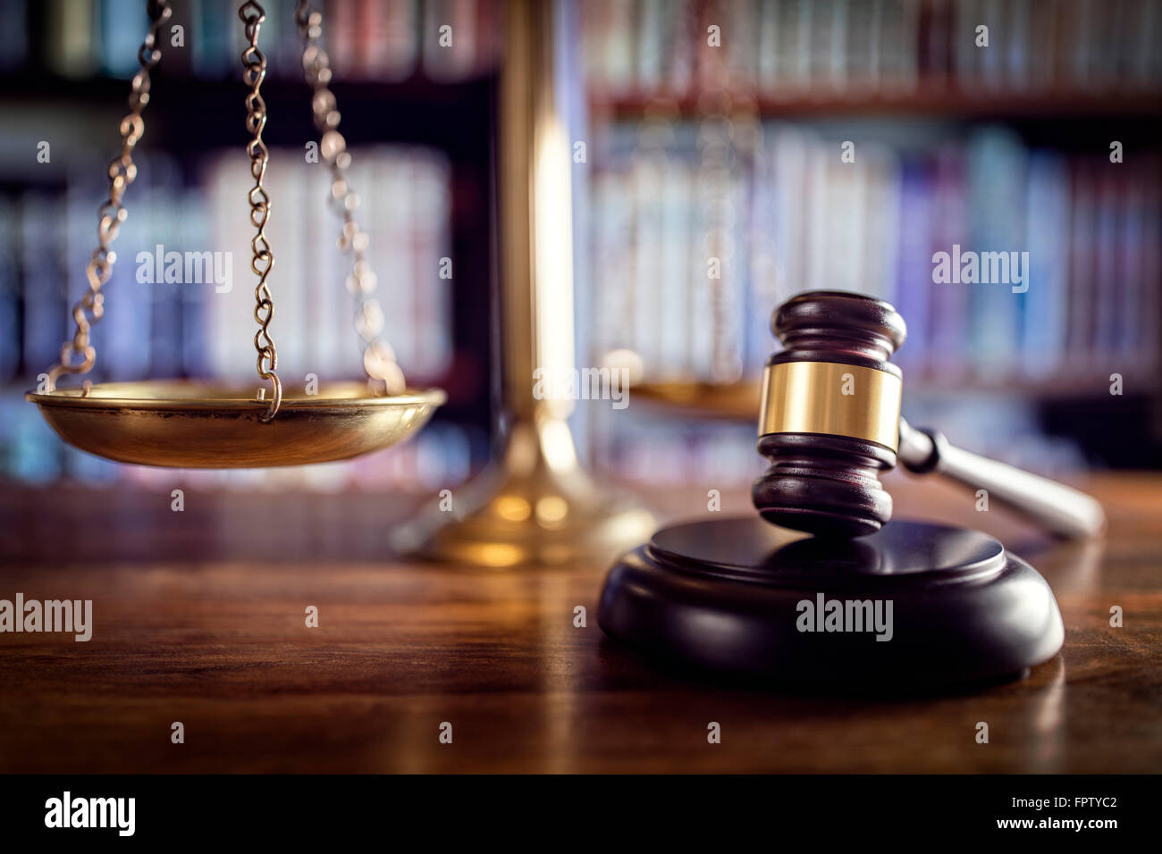 Gavel, scales of justice and law books - Stock Image