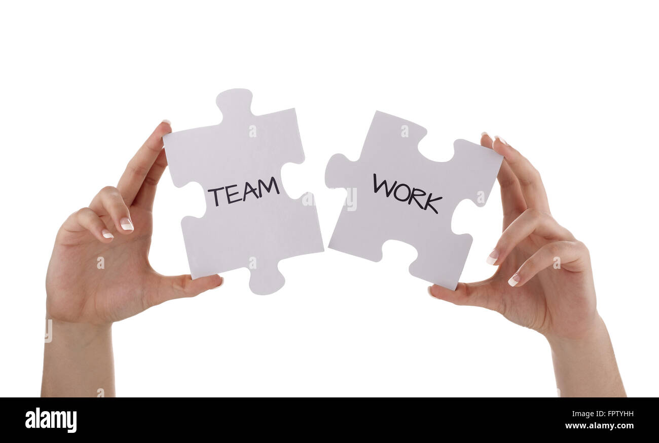Puzzle pieces joining together to read  teamwork concept for unity, business team or partnership - Stock Image