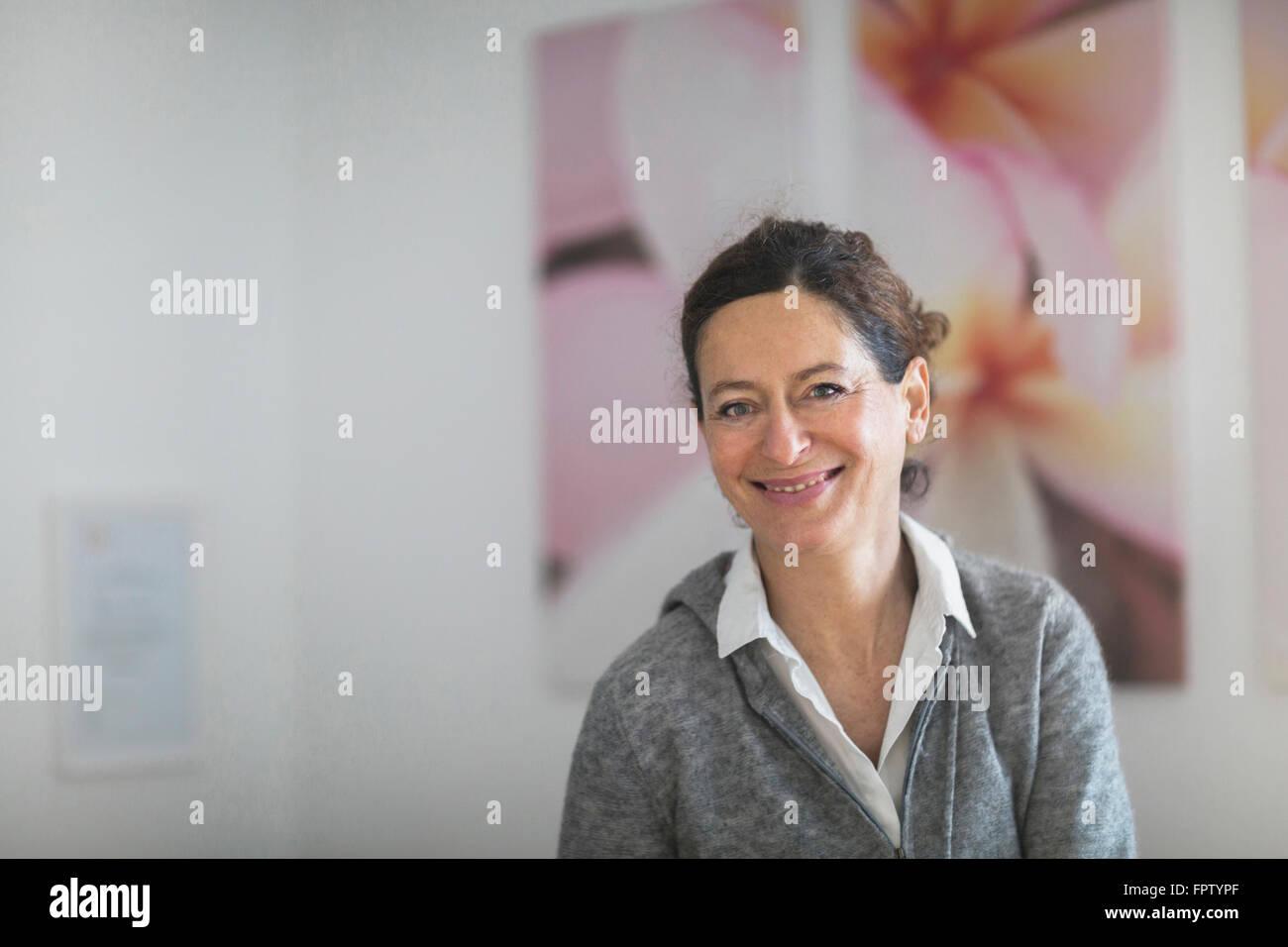 Portrait of a female physiotherapist smiling, Freiburg Im Breisgau, Baden-Württemberg, Germany - Stock Image