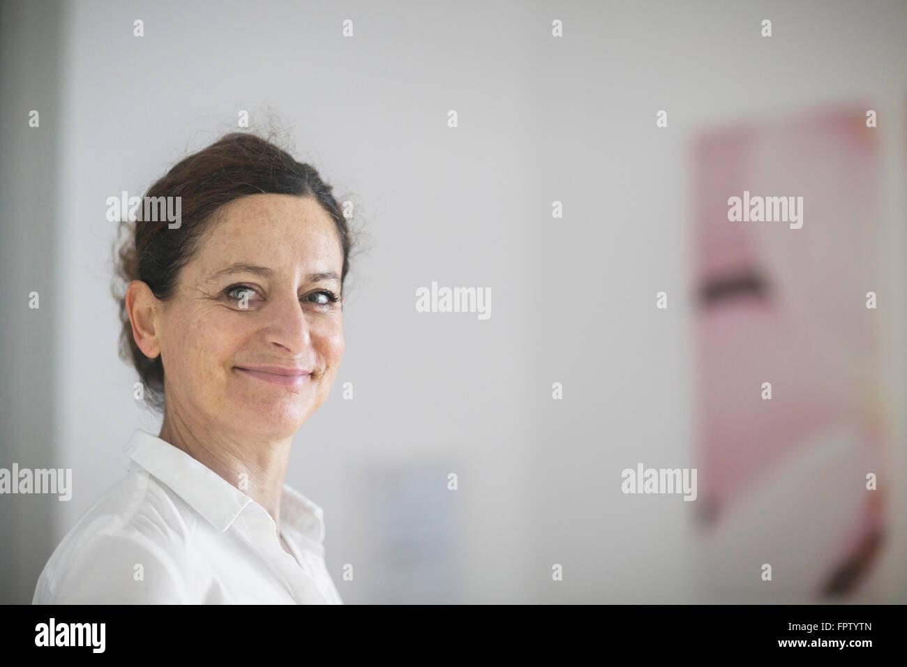 Portrait of a female doctor smiling, Freiburg Im Breisgau, Baden-Württemberg, Germany - Stock Image