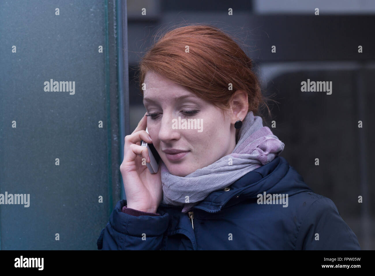 Young engineer talking on a mobile phone near switchgear in an industry, Freiburg im Breisgau, Baden-Württemberg, Stock Photo
