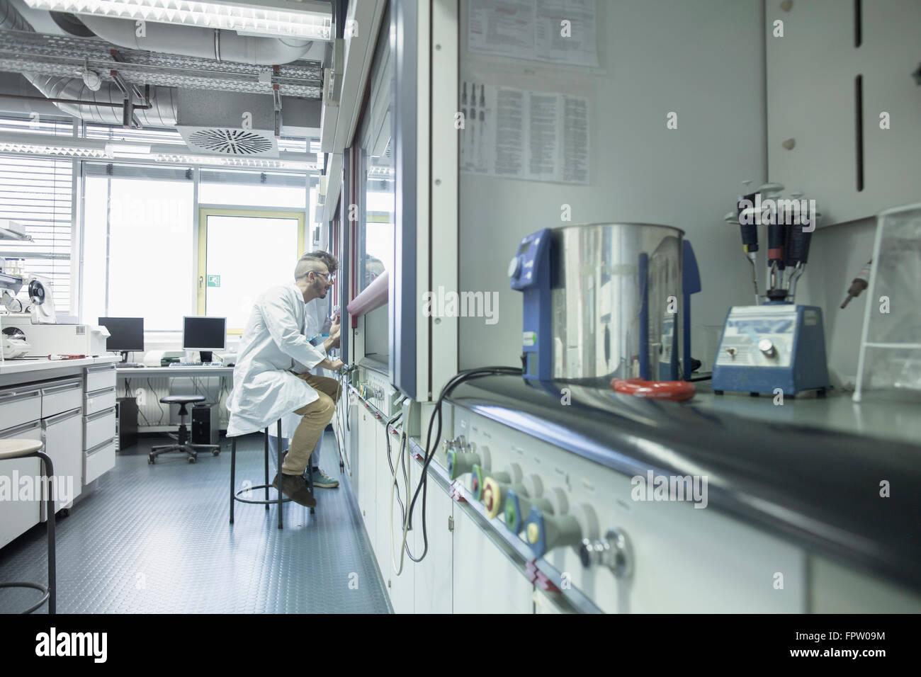 Two scientist working in a pharmacy laboratory, Freiburg Im Breisgau, Baden-Württemberg, Germany - Stock Image