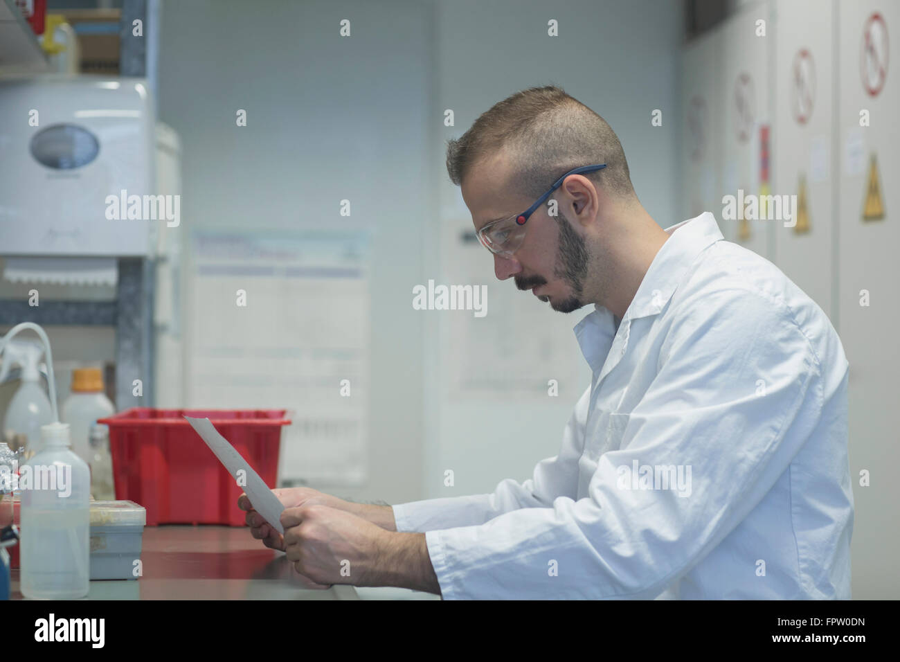 Young scientist working in a pharmacy laboratory, Freiburg Im Breisgau, Baden-Württemberg, Germany - Stock Image