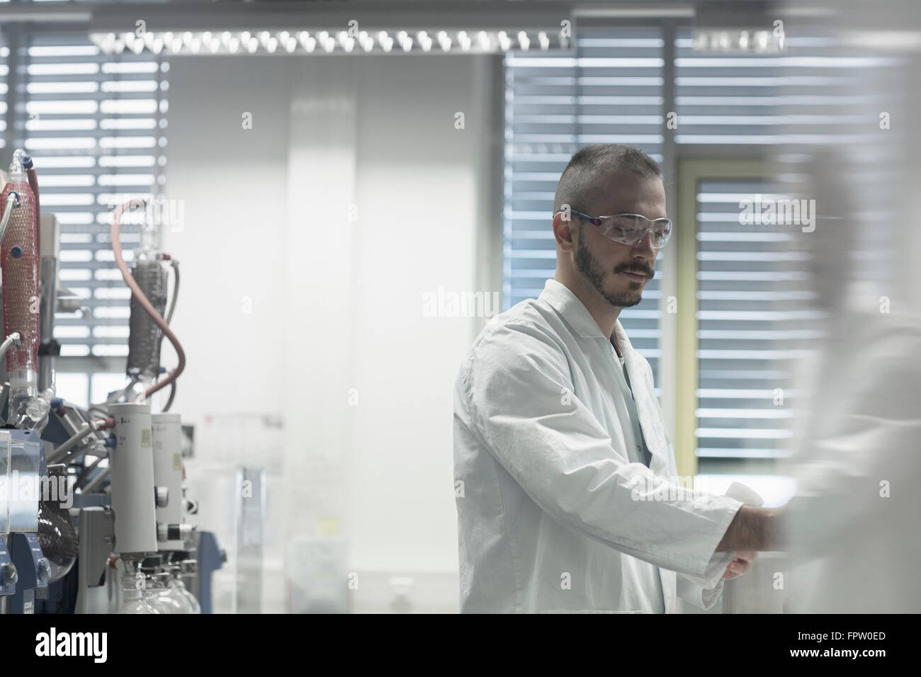 Young scientist working in a pharmacy lab, Freiburg Im Breisgau, Baden-Württemberg, Germany - Stock Image
