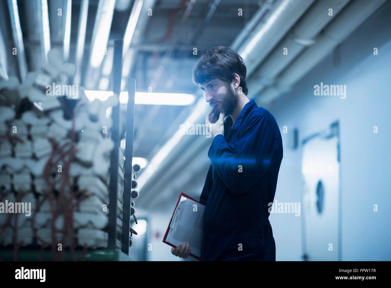 Young male engineer working in an industrial plant, Freiburg Im Breisgau, Baden-Württemberg, Germany Stock Photo