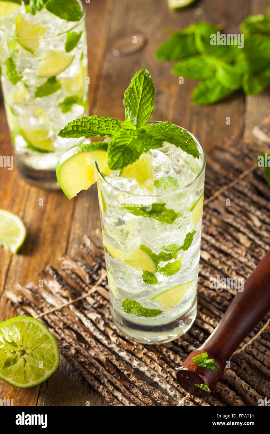 Homemade Alcoholic Mojito with LIme and Green Mint - Stock Image