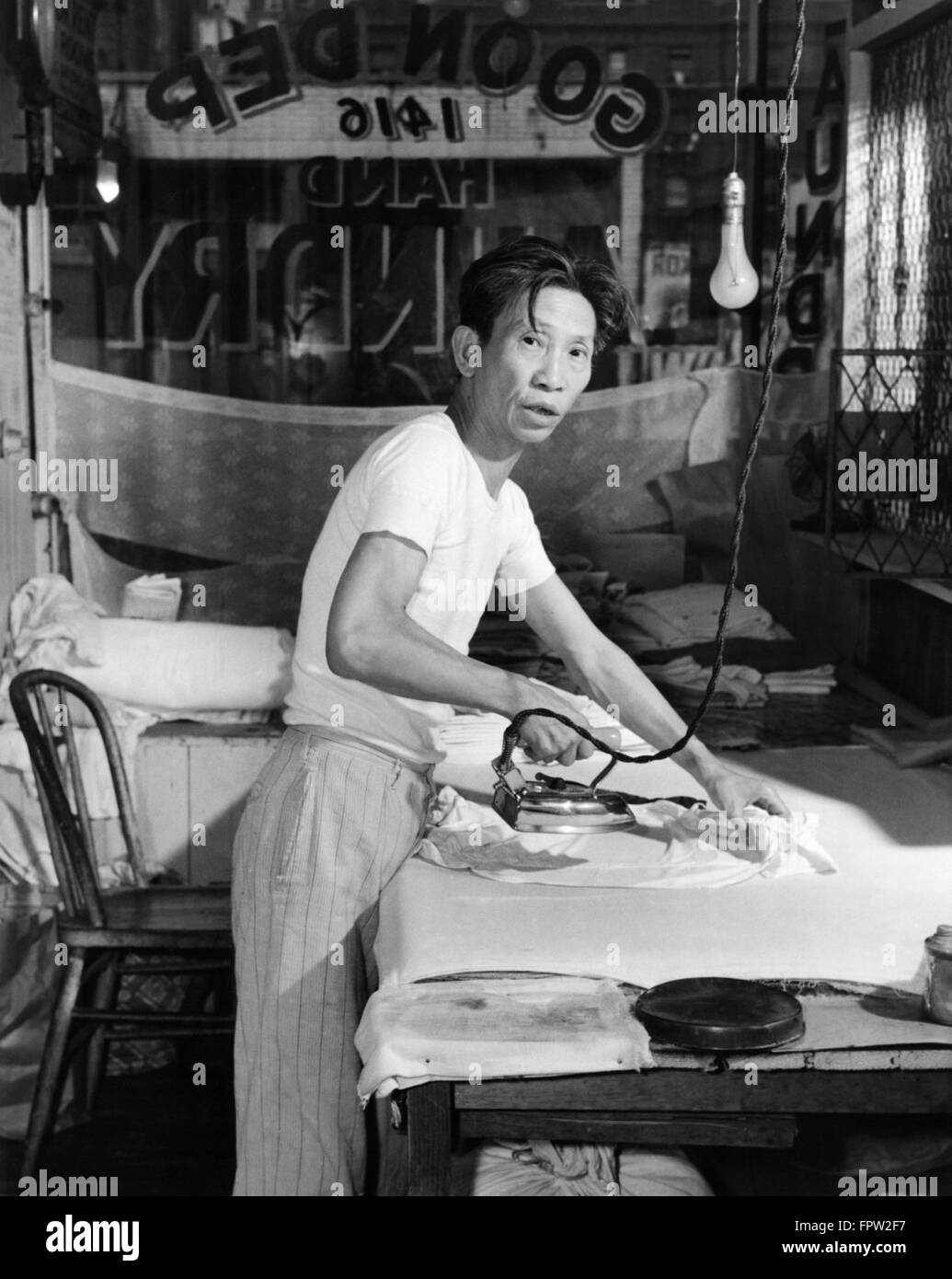 1920s-chinese-laundry-man-looking-at-cam