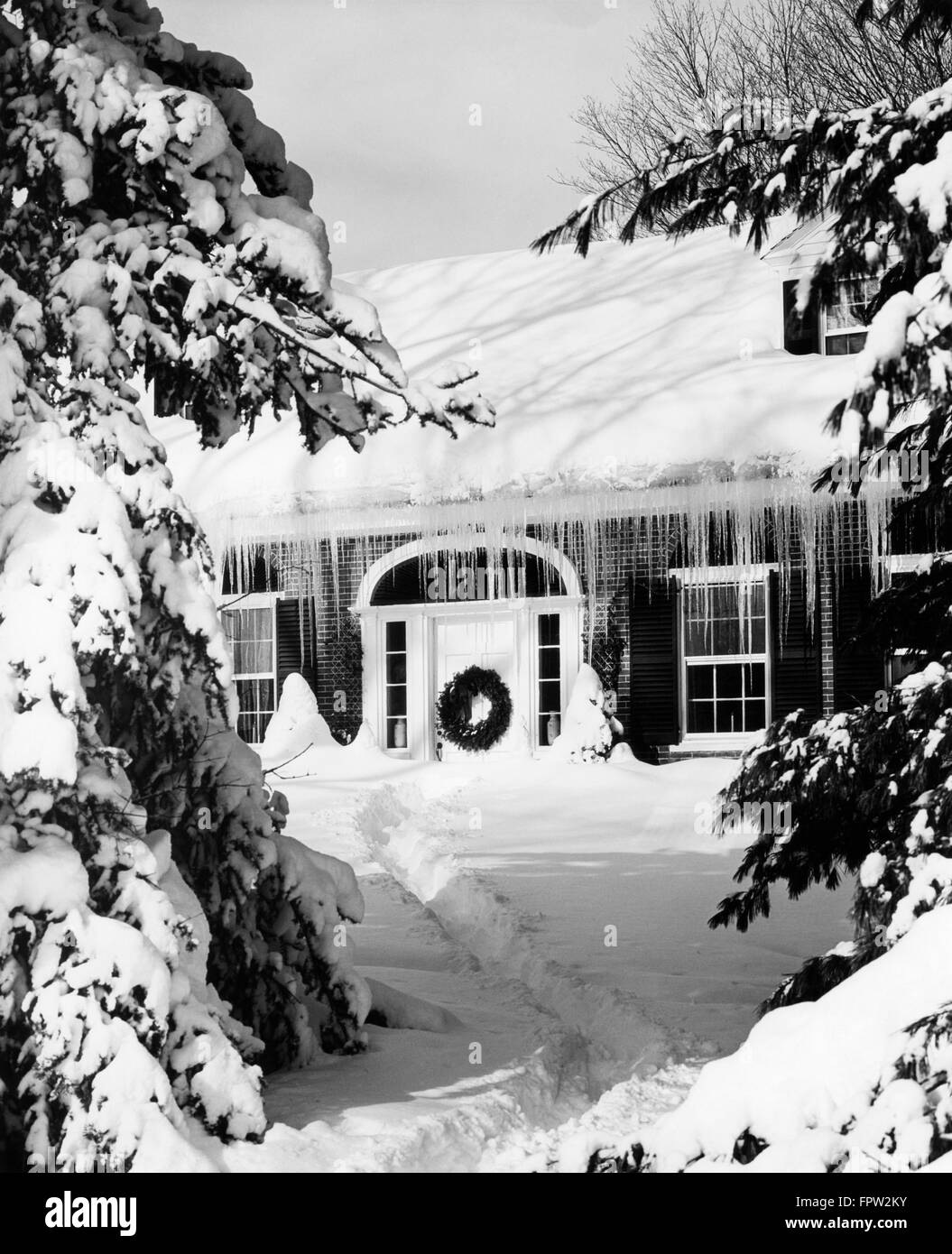 1960s SNOWED IN HOUSE IN WINTER ICICLES HANGING FROM ROOF FRONT DOOR ...