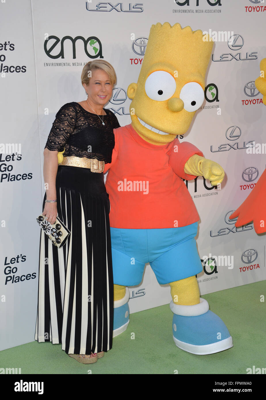 LOS ANGELES, CA - OCTOBER 24, 2015: Simpson's voice actress Yeardley Smith & Bart Simpson character at the - Stock Image