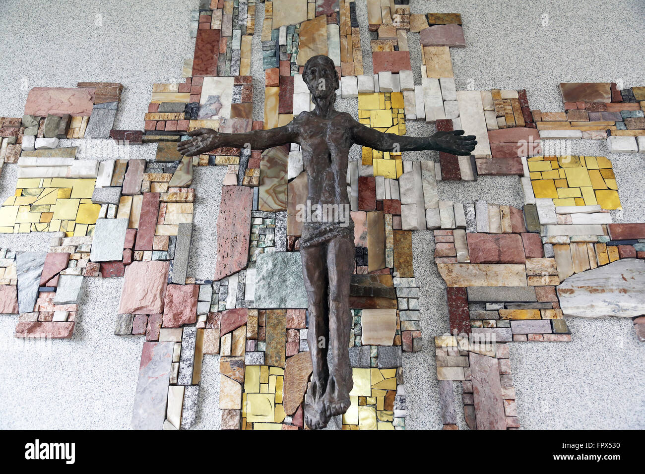 The crucifix in the parish church of St. Patrick work of painter Sieger Koder in Eggenrot, Germany - Stock Image