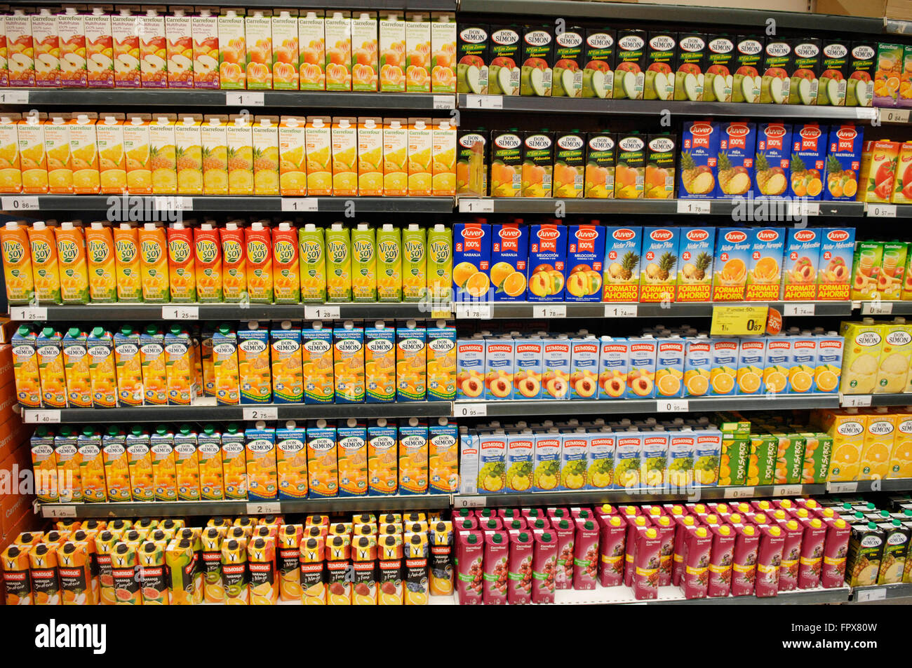 Selection of Juices on display at a Carrefour Supermarket in Malaga Spain. - Stock Image