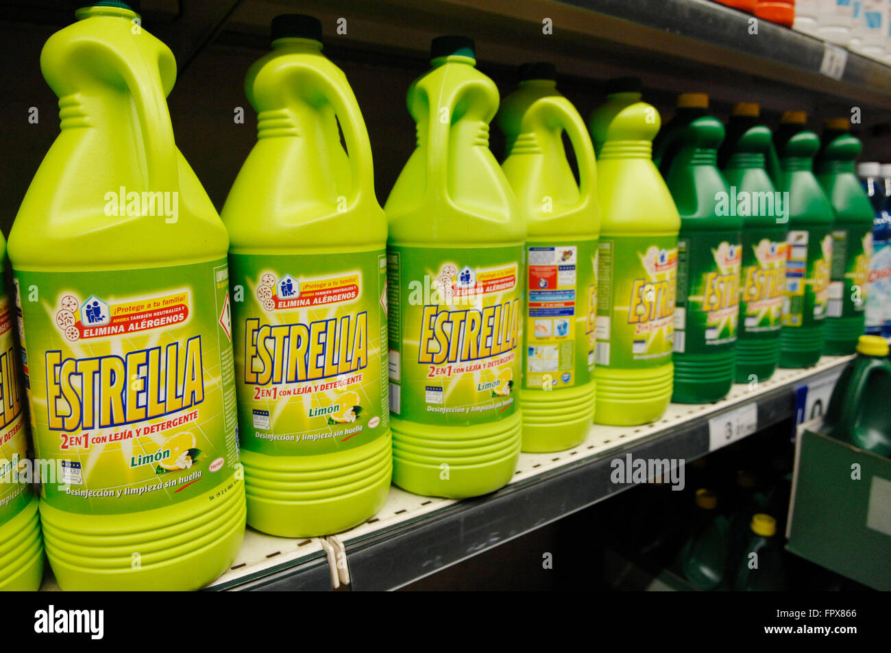 Estrella Bleach 1,5L Lemon containers on display in a Carrefour Supermarket Malaga Spain. - Stock Image