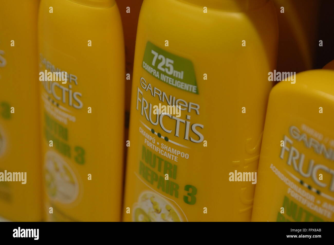 Garnier Fructis 3 oil on display in a Carrefour Supermarket. - Stock Image