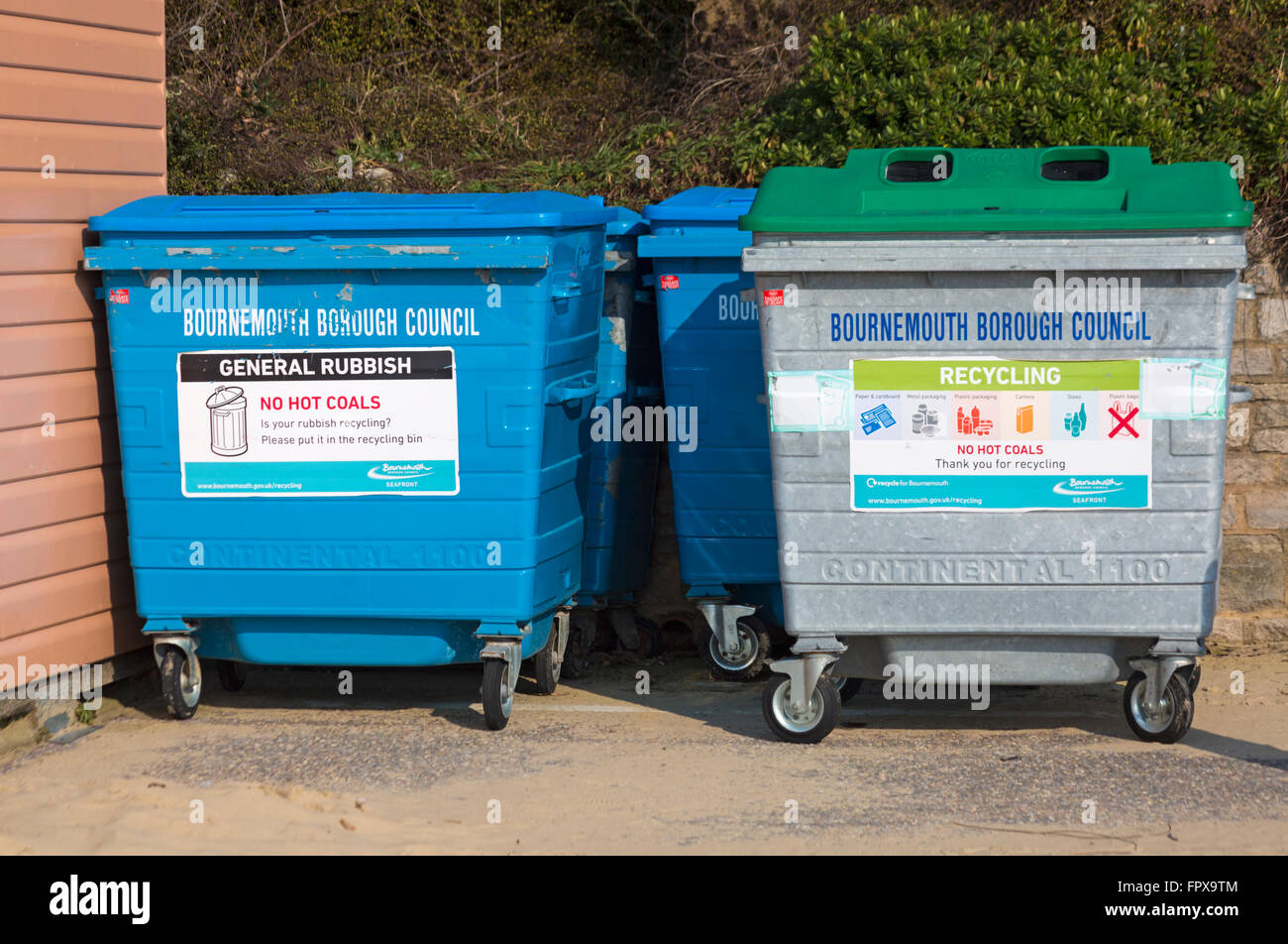 Bournemouth Borough Council recycling and general rubbish bins on promenade by beach huts at Bournemouth in March - Stock Image