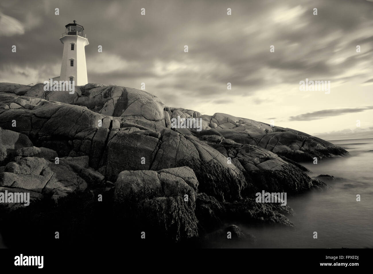monochrome peggys cove lighthouse in nova scotia - Stock Image